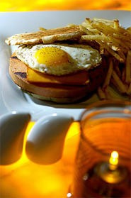 Fried bologna becomes haute cuisine at Michael Symon's Lola. - PHOTO BY WALTER NOVAK