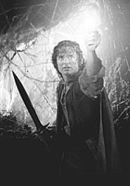 Frodo (Elijah Wood) lights the way in the final - installment of the Lord of the Rings epic.