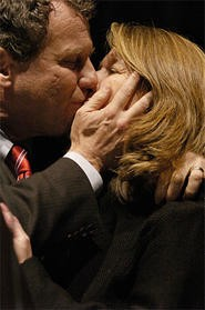 Get a room: Arm candy Sherrod Brown makes out with his  wife, Connie Schultz.