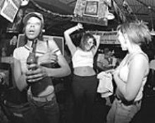 WALTER  NOVAK - Girls go wild at an otherwise typical sports bar.