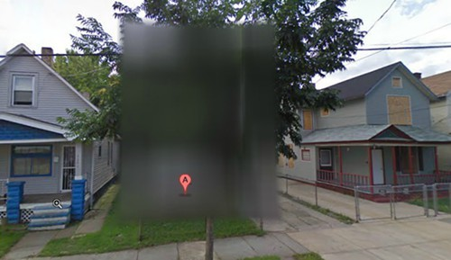 Google blurred out the house within Street View.