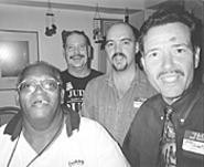 Greg Ammell (second from left), laughing with friends - at his Lakewood home.