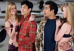 Guantanamo Baywatch: John Cho (second left) and Kal Penn tough it out in Gitmo.