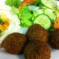 The Top 10 Must-Have Fried Foods in Cleveland Here's another hidden gem located in Northeast Ohio. Tarboosh Eatery in Parma has a deep fried all-star with their fried kibbeh. Finely crushed wheat and beef make up a shell that is stuffed with seven blends of seasonings, lamb, beef, and onion. The ball is then deep fried and served with a yogurt sauce. Tarboosh Eatery is located at 1144 W, Pleasant Valley Rd. Parma. Call 440-888-8899 for more information. Photo Courtesy of Bac Asian American Bistro & Bar