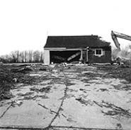 """House Being Demolished to Make Way for a Gated Community, Lyndhurst, Ohio,"" by Jeff Brouws, photograph."