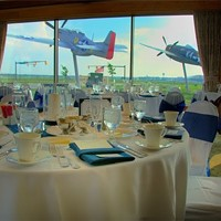 10 of Cleveland's Best Themed Restaurants How cool is it to stare out at a WWII airplane while dining? Even better is having a window seat to watch the planes take off and land at Cleveland-Hopkins Airport. That is exactly what to expect at the dining and private party landmark the 100th Bomber Group Restaurant.