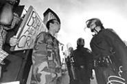 In a stand-off between protestors and working stiffs, - the crowd chose the cops. - WALTER  NOVAK