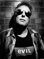 Jello Biafra, practicing his next mug shot.