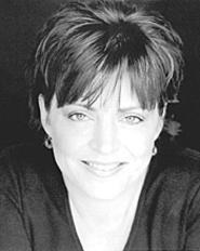 Kathleen Madigan talks about TV, hair, and stupid - people at Hilarities.