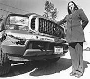 Kim Barry, next to the chariot she hopes will carry her - to Mayfield Heights City Council. - WALTER  NOVAK