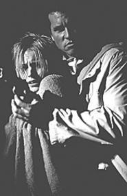 Kristen Bell and Val Kilmer run at the bad guys and - shoot them.