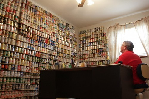 Lance Rice, at home among his beer can collection.