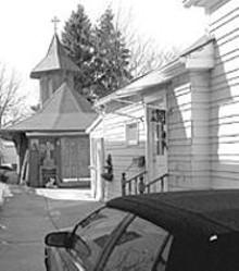 WALTER  NOVAK - Latovljevic (below)  imported Romanian pine to build his - backyard church.