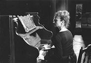 Laura Perrotta, seen here rendering fresh butter at the piano.