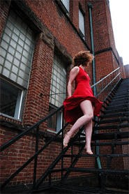 Laurel Johnson makes a fabulous whore, till AIDS takes her down in act two.