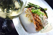 Lemon-basil cream sauce and artichoke risotto help wild Atlantic salmon leap with flavor. - WALTER NOVAK