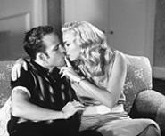 Leon (Stephen Dorff) and Betsy (Drea DeMatteo) get - close in Deuces Wild.