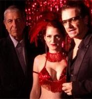Leonard Cohen (left), takes the stage with a burlesque girl and U2's Bono.