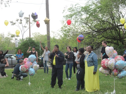 Local minister Loretta Freeman rallies the crowd Thursday night.