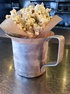 Many versions of popcorn have been popping up lately, but The Willeyville's is the most extreme and delicious. Served on their dinner menu, the spicy phat popcorn is tossed with pork fat, cilantro & jalapeno powder, and lime zest.