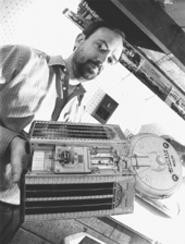Marc Millis and a spacecraft model he made in the basement. - WALTER  NOVAK
