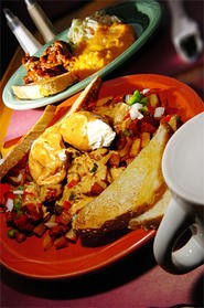 Market Hash's poached eggs rest on a zesty hash-brown bed. - WALTER NOVAK