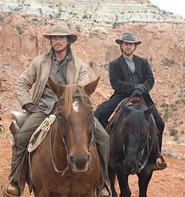 Marlboro man redux: Christian Bale (left) and Russell Crowe.