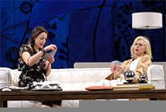 Matilde (Ursula Cataan, left) and Lane (Patricia Hodges, right) play cards in The Clean House.