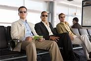 Matt Damon, George Clooney, and Brad Pitt patiently await their box-office percentage.