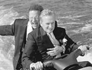 Michael Douglas and Albert Brooks ride hard for the - laughs in The In-Laws.