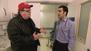 Michael Moore (left) tries to out the cancer in our tumor-ridden health-insurance industry.