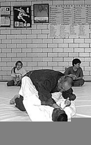Mid East Judo Clubbers body-slam with style.