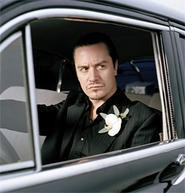 Mike Patton: From painters' caps to pinstripes.