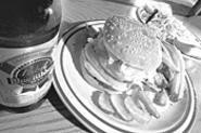 Mind your Manners: The Boulevard's behemoth burgers might remind you of days gone by. - WALTER  NOVAK