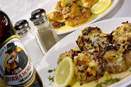 Mushroom caps (front) and Shrimp D'Agnese score with the help of lemon-butter sauce. - WALTER  NOVAK