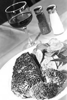 Nostalgia, ambiance, and entres like the black pepper      strip steak make John Q's a perennial draw.