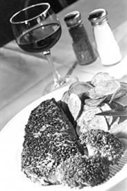 Nostalgia, ambiance, and entres like the black pepper - strip steak make John Q's a perennial draw. - WALTER  NOVAK