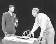Oliver Thompson (left) and John Lynch portray officers - embroiled in a murder investigation.