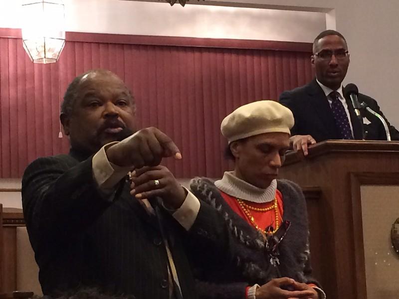 Pastor Larry D. Tatum attempts to calm the crowd. - ERIC SANDY / SCENE