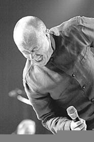 Phil Collins feels it coming at Gund Arena, September - 11. - WALTER  NOVAK