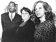 Plaintiff Terrance Jenkins, lawyer Merrie Frost, and - plaintiff Sonja Colwell say that juvenile court discriminates. - WALTER  NOVAK