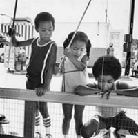 31 Vintage Photos of Kids Growing Up in Cleveland Playing a game at the Cuyahoga County fair, 1979.
