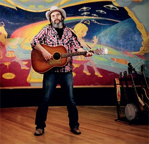 """""""Please welcome the next contestant at the Merryville Talent Show — Steve Earle."""""""