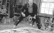 Pollock, slopping in the studio.