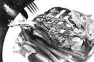 Pork chops don't get much better -- or bigger -- than - the honey-bourbon version at McKenna's. - WALTER  NOVAK