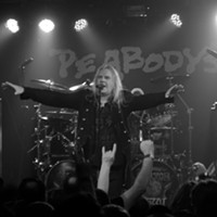Saxon performing at Peabody's