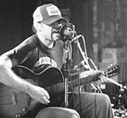 Scott H. Biram brings his trucker hat and his one-man band - to the Beachland on Thursday.