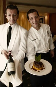 Server Oscar Califano (left) and Chef Luigi Iannuvario offer a tender osso buco paired with a well-balanced Barolo. - EARTHA GOODWIN