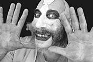 Sid Haig plays the scary daddy of a very scary Baby.