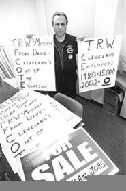 Signs of the times: UAW's John Reichbaum gets his message out. - WALTER  NOVAK